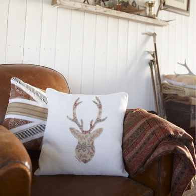 STAG CUSHION ON CHAIR